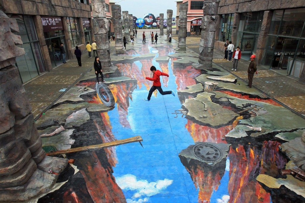 http://www.webdesignmash.com/design/stunning-optical-illusions-created-by-street-chalk-artists/